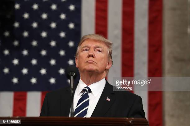 US President Donald Trump pauses while speaking during a joint session of Congress in Washington DC US on Tuesday Feb 28 2017 Trump will press...