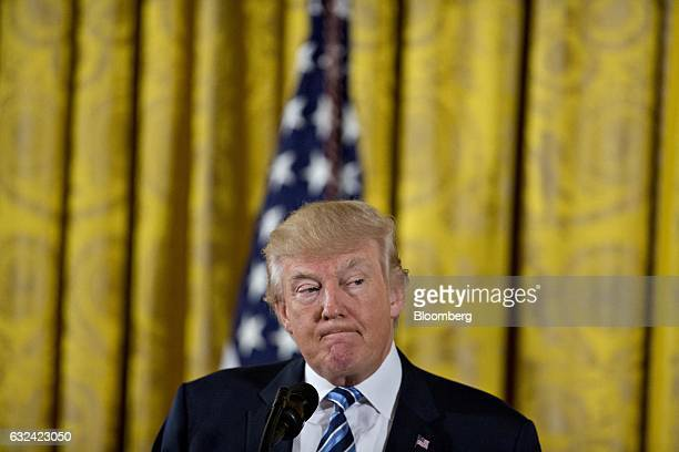 US President Donald Trump pauses while speaking during a swearing in ceremony of White House senior staff in the East Room of the White House in...