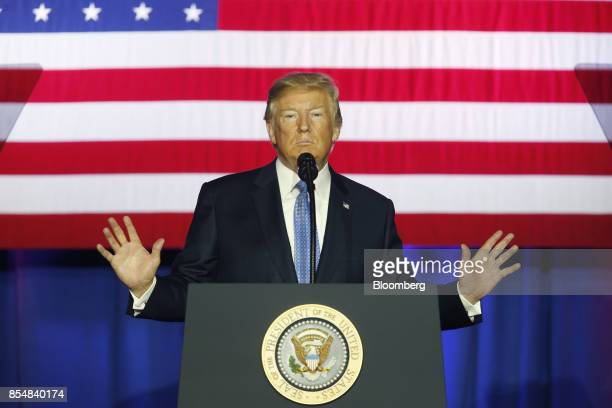 US President Donald Trump pauses while speaking during an event to discuss tax reform at the Indiana Farm Bureau building on the Indiana State...