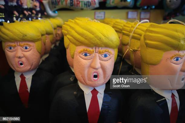 President Donald Trump pinatas are offered for sale in a party store along a commercial strip in the predominately Mexican Little Village...