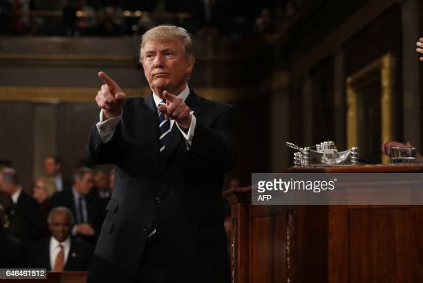 US President Donald Trump points to the audience after addressing a joint session of Congress in Washington DC on February 28 2017 / AFP / EPA POOL /...