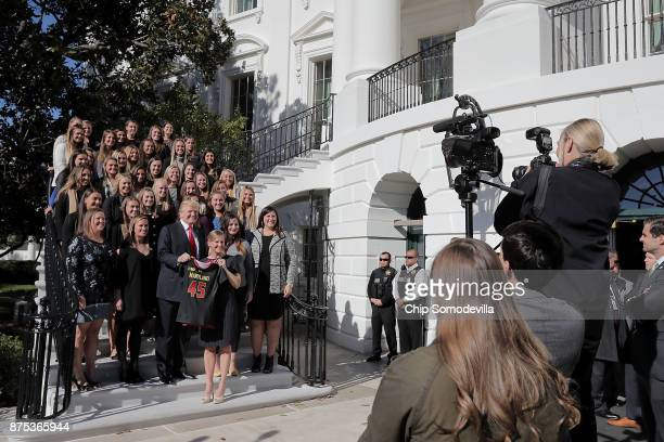 US President Donald Trump poses for photographs with members of the National Collegiate Athletic Association's champion University of Maryland...