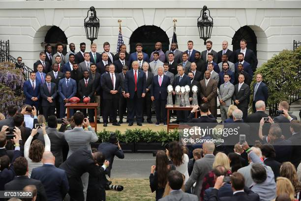 S President Donald Trump poses for photographs with the New England Patriots during a celebration of the team's Super Bowl victory on the South Lawn...