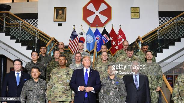 US President Donald Trump poses with generals and other military officials at the 8th Army Operational Command Centre at Camp Humphreys in Pyeongtaek...