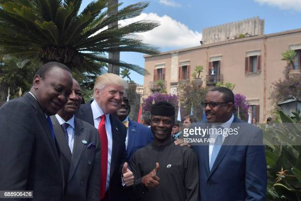 President Donald Trump poses with Kenya's President Uhuru Kenyatta Guinea's President Alpha Conde Vice President of Nigeria Yemi Osinbajo and...