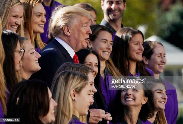 US President Donald Trump poses with members of the University of Washington women's rowing team on the South Lawn of the White House during an event...