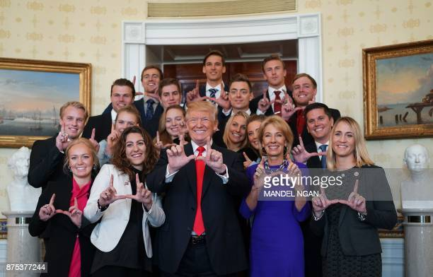 US President Donald Trump poses with members of the University of Utah ski team in the Blue Room of the White House during an event honoring the NCAA...