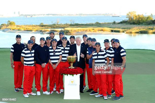 President Donald Trump poses with the victorious United States team led by Steve Stricker after their 1911 win during the final day singles matches...