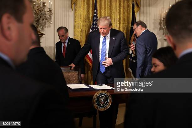 S President Donald Trump prepares to sign the Department of Veterans Affairs Accountability and Whistleblower Protection Act of 2017 during a...