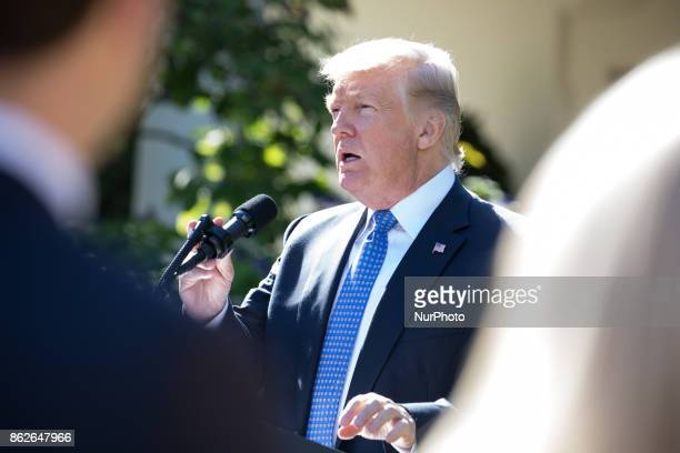 US President Donald Trump prepares to speak at his joint press conference with Prime Minister Alexis Tsipras of Greece in the Rose Garden of the...