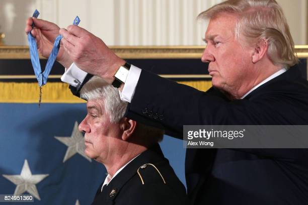 S President Donald Trump presents the Medal of Honor to former Army Specialist James McCloughan of South Haven Michigan during an East Room ceremony...