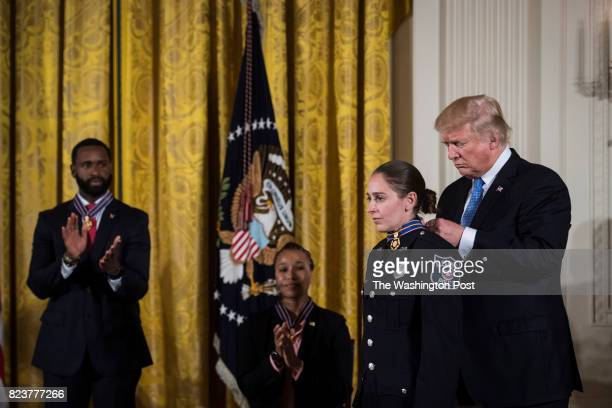 President Donald Trump presents the Medal of Valor to Alexandria Virginia Police Department Officer Nicole Battaglia during a ceremony honoring the...
