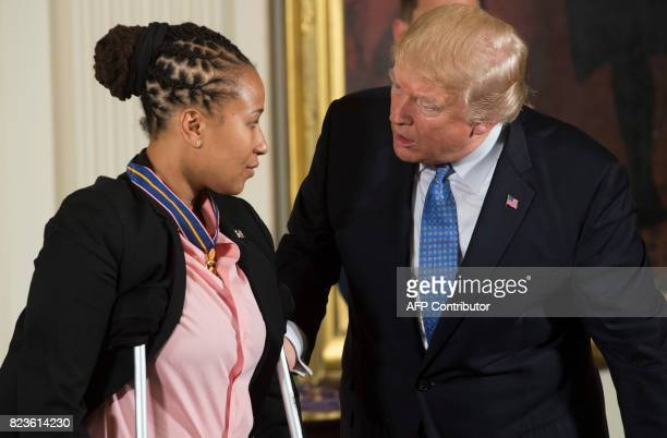 US President Donald Trump presents the Medal of Valor to US Capitol Police Officer Crystal Griner during a ceremony honoring the first responders of...