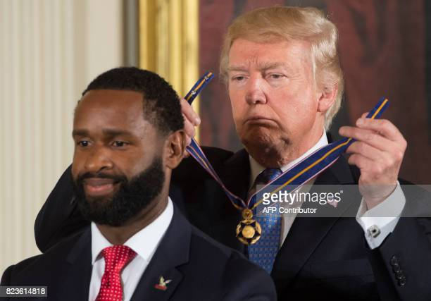 US President Donald Trump presents the Medal of Valor to US Capitol Police Officer David Bailey during a ceremony honoring the first responders of...
