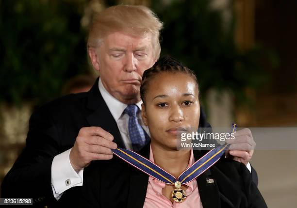 S President Donald Trump presents the Medal of Valor to US Capitol Police officer Crystal Griner during an event in the East Room of the White House...