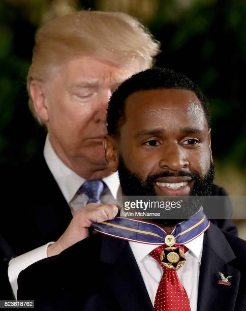 S President Donald Trump presents the Medal of Valor to US Capitol Police special agent David Bailey during an event in the East Room of the White...
