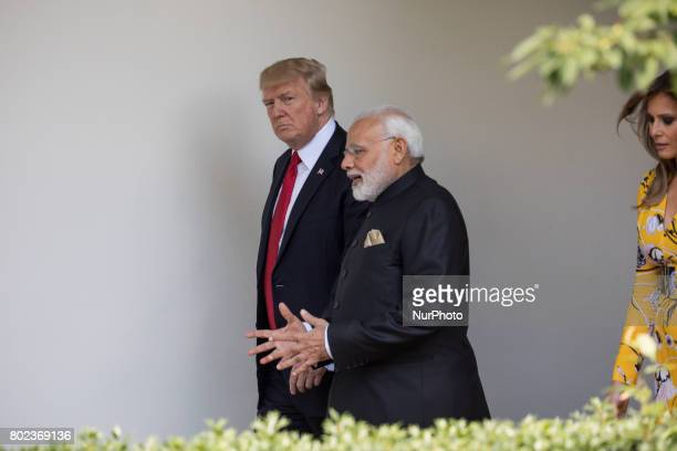 President Donald Trump Prime Minister Narendra Modi of India and First Lady Melania Trump walk down the West Wing Colonnade on the way to the Oval...