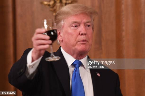 US President Donald Trump proposes a toast during a state banquet dinner with Japanese Prime Minister Shinzo Abe in Tokyo on November 6 2017 Donald...