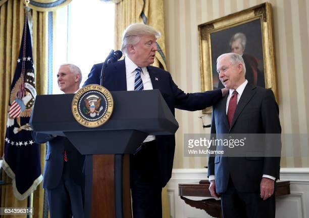 S President Donald Trump put his hand on the shoulder of Sen Jeff Sessions after introducing him before Sessions's swearing in ceremony in the Oval...