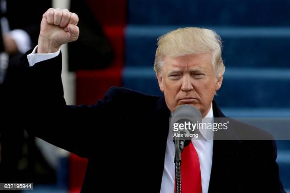 President Donald Trump raises a fist after his inauguration on the West Front of the US Capitol on January 20 2017 in Washington DC In today's...