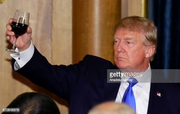 President Donald Trump raises a toast during a dinner hosted by Japanese Prime Minister Shinzo Abe at Akasaka Palace in Tokyo Japan on November 6 2017