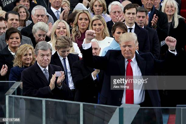 President Donald Trump raises his fists after his inauguration on the West Front of the US Capitol on January 20 2017 in Washington DC In today's...