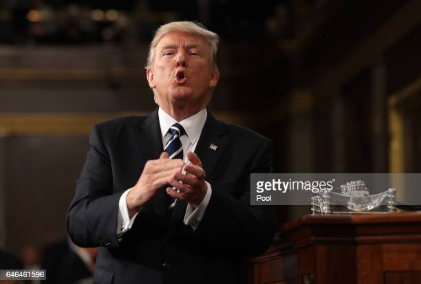 US President Donald Trump reacts after delivering his first address to a joint session of the US Congress on February 28 2017 in the House chamber of...