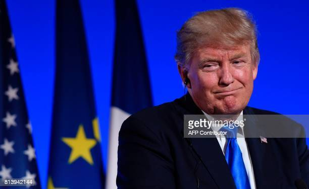 US President Donald Trump reacts during a press conference with the French President following meetings at the Elysee Palace in Paris on July 13...