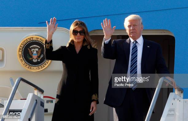 S President Donald Trump right and his wife Melania disembark from Air Force One at Fiumicino international airport Trump will meet Pope Francis at...