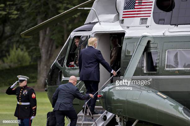 US President Donald Trump right and HR McMaster national security advisor board Marine One on the South Lawn of the White House in Washington DC US...