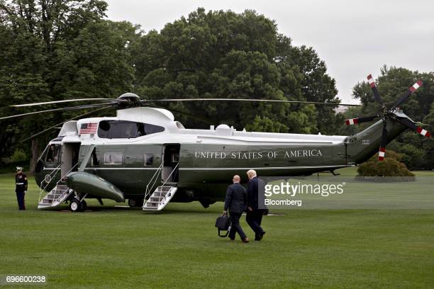 US President Donald Trump right and HR McMaster national security advisor walk toward Marine One on the South Lawn of the White House in Washington...