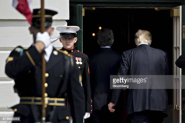 US President Donald Trump right and Mauricio Macri Argentina's president walk into the Whiter House at the South Portico in Washington DC US on...