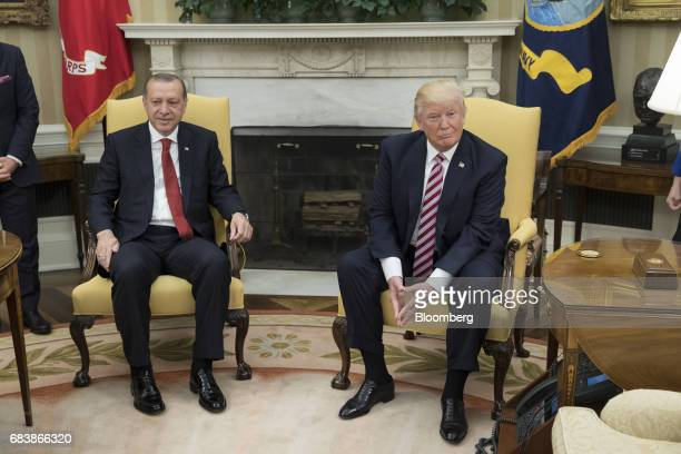 US President Donald Trump right and Recep Tayyip Erdogan Turkey's president sit during a meeting at the Oval Office of the White House in Washington...