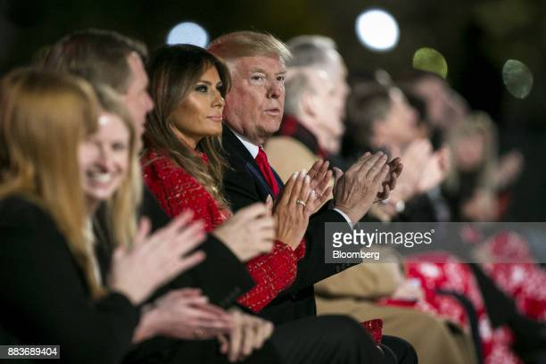 US President Donald Trump right and US First Lady Melania Trump applaud during the 95th Annual National Christmas Tree Lighting in Washington DC US...