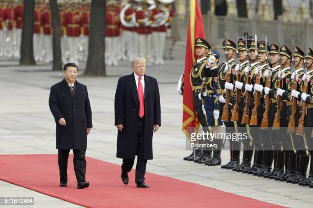 US President Donald Trump right and Xi Jinping China's president walk past members of the People's Liberation Army during a welcome ceremony outside...