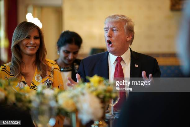 US President Donald Trump right delivers remarks as US First Lady Melania Trump smiles before dinner with Narendra Modi India's prime minister at the...