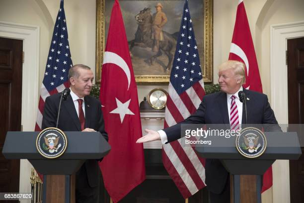 US President Donald Trump right extends a hand to Recep Tayyip Erdogan Turkey's president during a news conference at the Roosevelt Room of the White...