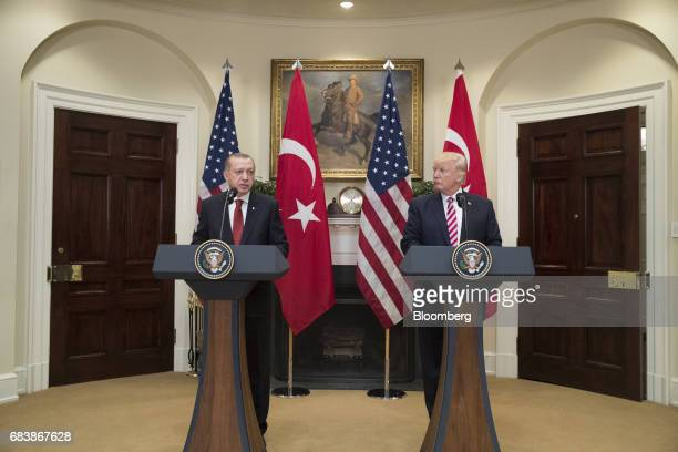 US President Donald Trump right listens as Recep Tayyip Erdogan Turkey's president speaks during a news conference at the Roosevelt Room of the White...
