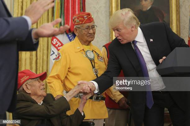 US President Donald Trump right shakes hands with a World War II veteran during an event honoring Native American 'Code Talkers' inside the Oval...