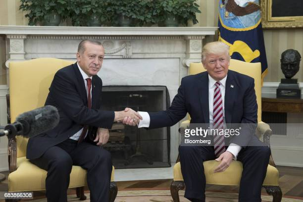 US President Donald Trump right shakes hands with Recep Tayyip Erdogan Turkey's president during a meeting at the Oval Office of the White House in...