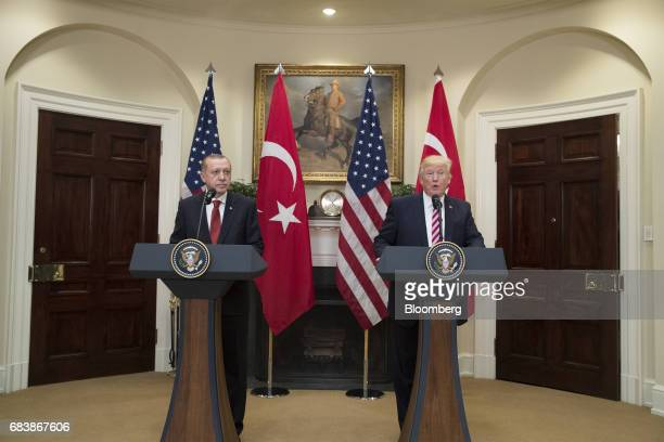 US President Donald Trump right speaks as Recep Tayyip Erdogan Turkey's president listens during a news conference at the Roosevelt Room of the White...
