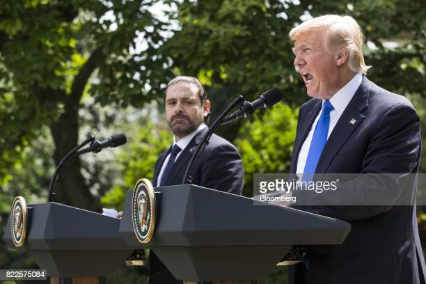 US President Donald Trump right speaks as Saad Hariri Lebanon's prime minister listens during a joint press conference in the Rose Garden of the...