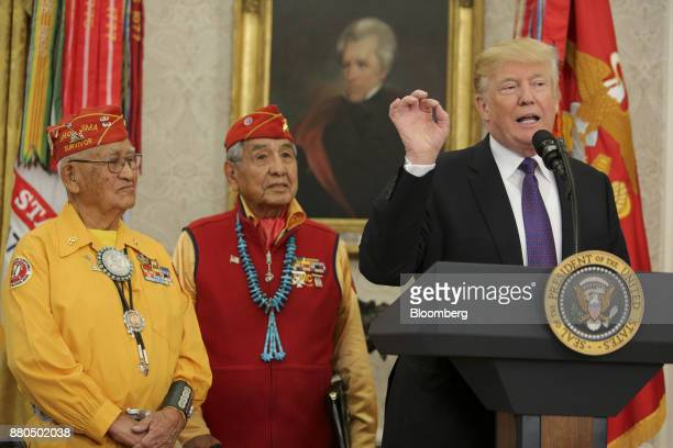 US President Donald Trump right speaks during an event honoring World War II veteran Native American 'Code Talkers' inside the Oval Officer of the...