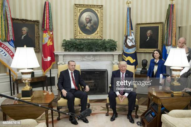 US President Donald Trump right speaks to members of the media as Recep Tayyip Erdogan Turkey's president listens during a meeting at the Oval Office...
