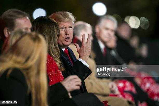 US President Donald Trump right speaks with US First Lady Melania Trump during the 95th Annual National Christmas Tree Lighting in Washington DC US...