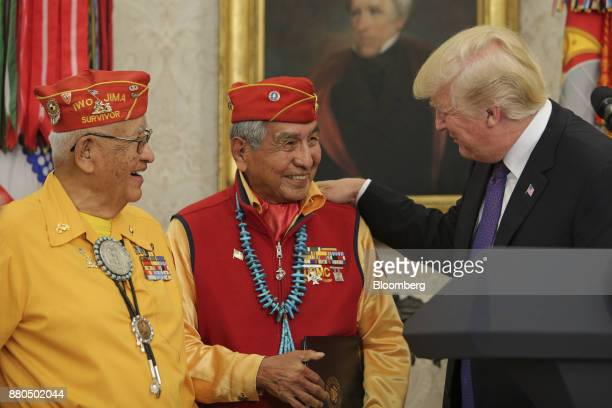 US President Donald Trump right speaks with World War II veterans during an event honoring Native American 'Code Talkers' inside the Oval Officer of...