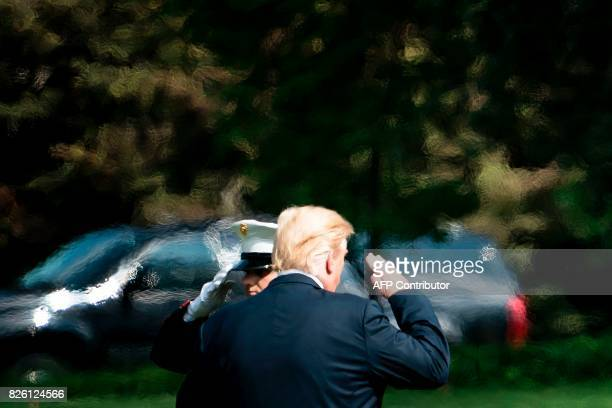 US President Donald Trump salutes as he boards Marine One on the South Lawn of the White House August 3 2017 in Washington DC Special counsel Robert...