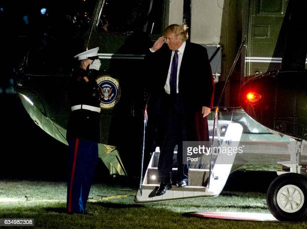 S President Donald Trump salutes as he returns to the White House February 12 2017 in Washington DC The president spent the weekend with Japanese...
