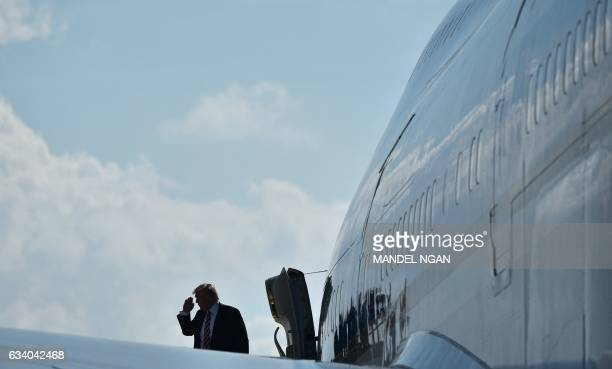 US President Donald Trump salutes before boarding Air Force One from MacDill Air Force Base on February 6 2017 in Tampa Florida President Donald...