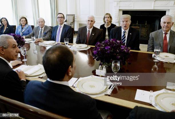 US President Donald Trump second right and his cabinet meets with AbdelFattah ElSisi Egypt's president and his delegation during a working lunch in...